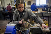 A workers polishing blades. J Adams and Sons manufacture a range of military and cooking knives out of steel using traditional hand based production methods. The family business employs around 16 peop... - Connor Matheson - 18-05-2015