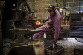 A workers bashing hot steel. J Adams and Sons manufacture a range of military and cooking knives out of steel using traditional hand based production methods. The family business employs around 16 peo... - Connor Matheson - 18-05-2015
