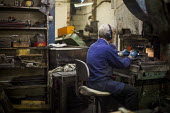 A worker cutting steel. J Adams and Sons manufacture a range of military and cooking knives out of steel using traditional hand based production methods. The family business employs around 16 people p... - Connor Matheson - 18-05-2015