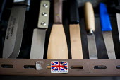 Finished knives ready for shipping on the shelf by a made in Britain sticker. J Adams and Sons manufacture a range of military and cooking knives out of steel using traditional hand based production m... - Connor Matheson - 18-05-2015