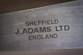 J Adams logo on a finished knife. J Adams and Sons manufacture a range of military and cooking knives out of steel using traditional hand based production methods. The family business employs around 1... - Connor Matheson - 2010s,2015,American,americans,blade,blades,business,capitalism,craft,craftsman,EBF,Economic,Economy,employee,employees,Employment,FACTORIES,factory,families,family,forge,forged and cast steel products