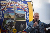 An ex miner beaten and charged with riot during the battle of Orgeave speaking to Campaigners and supporters rally to mark the 31st anniversary of the battle of Orgreave which took place during the 19... - Connor Matheson - Miners Strike, Trades Union,2010s,2015,abuse,activist,activists,adult,adults,anniversary,banner banners,Battle of Orgreave,CAMPAIGN,campaigner,campaigners,CAMPAIGNING,CAMPAIGNS,DEMONSTRATING,demonstra