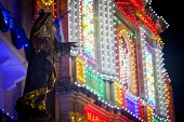 The Feast of Our Lady of Sorrows St. Pauls Bay Malta. Church lit up by hundreds of lightbulbs. The celebration is traditionally a celebration of the patron saint, but today the event is more of a comm... - Connor Matheson - &,2010s,2015,ACE,art,artwork,artworks,at,Belief,Catholic,catholicism,Catholics,CELEBRATE,CELEBRATING,celebration,CELEBRATIONS,christian,christianity,christians,church,churches,communities,community,co