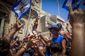 The Feast of Our Lady of Sorrows St. Pauls Bay Malta, cheering and jumping in the air outside the village church - Connor Matheson - 26-07-2015