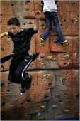 Sports at the Bolton Lads and Girls Club which is partly funded by Sport England and is encouraging children to continue participating in sport after they leave full-time education. - Christopher Thomond - ,2000s,2005,active,adolescence,adolescent,adolescents,boy,boys,child,CHILDHOOD,children,climb,climbing,club,clubs,encouraging,equipment,exercise,exercises,exercising,female,females,girl,girls,jump,jum