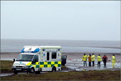 The search and rescue operation ( 6th February 2004) in Morecambe Bay, Lancashire, after cockle fishers were stranded on sandbanks by the incoming rising tide. The Chinese gangmaster, Lin Liang Ren wa... - Christopher Thomond - 2000s,2004,accident,accidental,accidents,Ambulance,Ambulances,Chinese,coastguard,coastguards,cockler,cocklers,cockling,crop,crops,danger,dangerous,dark,death,deaths,dia accident and disaster,Diaspora,