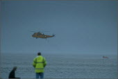 The search and rescue operation ( 6th February 2004) in Morecambe Bay, Lancashire, after cockle fishers were stranded on sandbanks by the incoming rising tide. The Chinese gangmaster, Lin Liang Ren wa... - Christopher Thomond - 2000s,2004,accident,accidental,accidents,air,air transport,aircraft,aviation,Chinese,coastguard,coastguards,cockler,cocklers,cockling,crop,crops,danger,dangerous,dark,death,deaths,dia,dia accident and