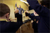 Manchester Education Authority senior voice tutor Maurice Walsh singing with Key Stage 2 pupils, Acacias Community Primary School, Burnage, Manchester. - Christopher Thomond - 08-04-2005