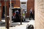 POlice search team in action in the streets around Fishwick Parade in Preston where 20 year old Shezan Umarji was stabbed to death in the early hours of Saturday in a racist incident. - Christopher Thomond - 2000s,2006,adult,adults,asian,bigotry,black,BME Black minority ethnic,CLJ crime,death,DEATHS,died,DISCRIMINATION,equal,equality,force,Housing Estate,incident,incidents,INEQUALITY,inquiry,looking,MATUR