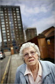 Dolly Lloyd who is concerned about the changing demographics of the inner city Vauxhall area of Liverpool as her bungalow is rapidly surrounded by new apartment blocks for students. - Christopher Thomond - ,2000s,2006,age,ageing population,apartment,blocks,bungalow,cities,city,elderly,FEMALE,High Rise,housing,Liverpool,old,people,person,persons,scene,scenes,soi social issues,street,streets,tenant,tenant