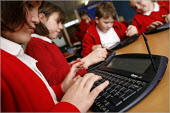 Pupils using their mini WiFi enabled laptops at the Hope School CE in Shropshire. - Christopher Thomond - 01-12-2005