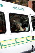 An elderly patient waiting in an ambulance outside St James' Hospital in Leeds. - Christopher Thomond - 10-06-2008