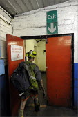 Miner leaving at the end of his shift, Daw Mill Colliery, Warwickshire. - Christopher Thomond - 2000s,2008,change,coal,coal industry,coal mining,coalfield,coalindustry,collieries,Colliery,colliery collieries,coming off,dirt dirty,EBF Economy,helmet helmets,LAB LBR Work,leaving,man men,manual,min