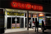 Staff leaving Woolworths' store in Cheshire, as it closes its doors for the final time. - Christopher Thomond - 2000s,2009,adult,adults,at,bag,bags,bought,business,buy,buyer,buyers,buying,centre,centres,CLOSED,closing,closure,closures,commodities,commodity,consumer,consumers,couple,couples,Credit Crunch,crisis,