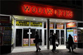 Staff leaving Woolworths' store in Cheshire, as it closes its doors for the final time. - Christopher Thomond - 2000s,2009,at,bag,bags,bought,business,buy,buyer,buyers,buying,centre,centres,CLOSED,closing,closure,closures,commodities,commodity,consumer,consumers,Credit Crunch,crisis,customer,customers,doors,DOW