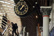 Passengers at York Railway Station - Christopher Thomond - 2000s,2009,carriage,carriages,cities,city,clock,clocks,EBF,ebf Economy,Economic,Economy,infrastructure,journey,journeys,male,man,men,network,passenger,passengers,people,person,persons,platform,PLATFOR