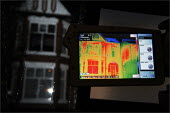 Thermographers from Heatseekers analysing heat loss from homes in Salford. The van based infrared camera scans houses and the results are used to inform residents who may need to improve home insulati... - Christopher Thomond - 19-01-2009