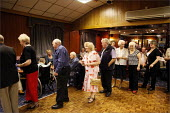 Queueing for bingo cards at Cleveleys Working Men's Club, Lancashire. - Christopher Thomond - 2000s,2009,age,ageing population,bingo,club,clubs,drink,drinking,drinks,elderly,FEMALE,Leisure,LFL,LFL Leisure,LICENSED,LIFE,line,male,man,men,men's,Night Out,nightlife,old,people,person,persons,pub,P