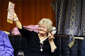 A woman claims a win on the bingo at the Cleveleys Working Men's Club, Lancashire. - Christopher Thomond - ,2000s,2009,age,ageing population,bingo,club,clubs,drink,drinking,drinks,elderly,EMOTION,EMOTIONAL,EMOTIONS,FEMALE,gambling,game,games,Leisure,LFL,LFL Leisure,LICENSED,LIFE,men's,Night Out,nightlife,o