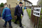 Voters in the county council and european elections at a polling station in a terraced house on the Turf Moor estate in Burnley, Lancashire. - Christopher Thomond - 04-06-2009