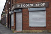 A closed corner shop in the Derker area of Oldham, due to be redeveloped as part of a government Pathfinder scheme. . - Christopher Thomond - 12-06-2009