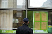 A man looking for work in the window at Bury JobCentre Plus office - Christopher Thomond - 17-06-2009