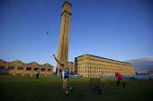 Young men play an impromptu cricket match outside Lister's Mill in Bradford, once the largest silk factory in the world, now partly renovated turned into an apartment block. - Christopher Thomond - 27-07-2009