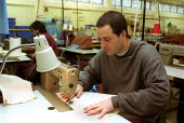 Inmate at sewing machine at Pentonville Prison in the Prison Workshop. - Duncan Phillips - 15-04-2000