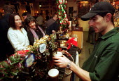 Bar Staff working in London Pub. - Duncan Phillips - 1990s,1999,Alcohol,Bar staff,bar tending,barmen,Bartender,bartenders,bartending,Christmas,cities,city,drink,Drinking,EARNINGS,EBF economy business,employee,employees,Employment,EQUALITY,female,guinnes