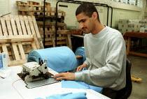 Prisoner sewing cloth, Prison Workshop Pentonville Prison. - Duncan Phillips - 15-04-2000