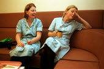 Nurses enjoying Tea Break at a North London Hospital - Duncan Phillips - ,2000,2000s,break,care,cities,city,coffee,enjoying,ENJOYMENT,Exhausted,Exhaustion,Fatigue,Fatigued,female,funny,HEA health,health,HEALTH SERVICES,healthcare,Hospital,HOSPITALS,hours,Humor,Humorous,hum
