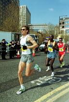 Flora London Marathon - Duncan Phillips - 2000s,2002,cities,city,exercise,exercises,exercising,fitness,health,LFL leisure,london,Marathon,PHYSICAL,Physical Fitness,run,runner,runners,running,SPO sport,Sport,sports,taking,urban