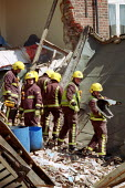 Firefighters using listening equipment to search a collapsed building where there was the possibility of trapped building workers. North London. - Duncan Phillips - 16-06-2002