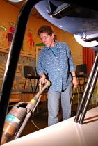 School cleaner at work in a Sheffield primary school - David Bocking - 29-11-2001