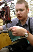 Shoe repairer at work on a pair of boots, Sheffield - David Bocking - 30-11-2001