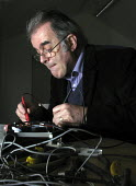 Gordon Ferguson of Repair Sheffield mending a cassette recorder. The voluntary group runs regular Repair Cafes where the public are shown how to mend many household items to help them save money and r... - David Bocking - 08-01-2015
