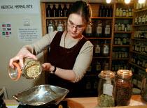 Medical herbalist preparing a herbal tea - David Bocking - 07-02-2002