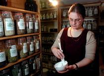 Medical herbalist preparing a tincture - David Bocking - 07-02-2002