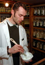 Medical herbalist preparing a medicine - David Bocking - 07-02-2002