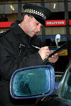 Trainee traffic warden booking an illegally parked car near Sheffield Markets - David Bocking - 15-03-2002