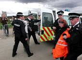 Barbara Maver & Sue Brackenbury (right) from Faslane Peace Camp being arrested for obstruction at the CND anti Star Wars demonstration at Fylingdales RAF base on 15th June 2002 - David Bocking - 15-06-2002
