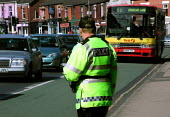 Traffic police motorcyclist monitoring rush hour traffic using bus lanes and issuing spot fines to transgressing motorists - David Bocking - 19-06-2002