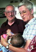 Foster carers with child at home in South Yorkshire - David Bocking - 16-08-2003