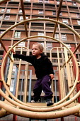Two year old in one of the playgrounds of Park Hill Flats, Sheffield - David Bocking - 30-09-2003