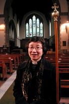 Woman vicar at her church in Endcliffe, Sheffield - David Bocking - 30-03-2004
