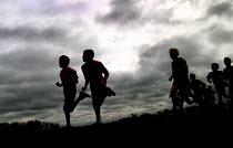 Ten and eleven year old boys set off on a school cross country race in Sheffield - David Bocking - ,2000s,2004,activity,adolescence,adolescent,adolescents,athletics,boy,boys,child,CHILDHOOD,children,comprehensive,COMPREHENSIVES,country,countryside,cross,edu education,education,juvenile,juveniles,ki