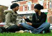 Muslim girls discussing politics during the 2005 general election campaign in Sheffield city centre - David Bocking - 2000s,2005,adolescence,adolescent,adolescents,argue,arguing,argument,black,BME Black minority ethnic,communicating,communication,conversation,conversations,DEMOCRACY,dialogue,discourse,discuss,discuss