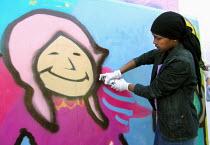 Girl working on a graffiti art workshop at Abbeydale Grange secondary school, Sheffield, during a celebration of the school's new media/arts specialist status. - David Bocking - 07-06-2005