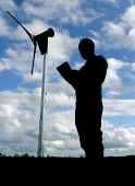 Sheffield farmer monitors the wind turbine used to power his farm - David Bocking - 2000s,2006,AGRICULTURAL,agriculture,Alternative Energy,capitalism,capitalist,country,countryside,EBF,EBF Economy,Economic,Economy,electric,electrical,electricity,energy,energy supply,eni,ENI environme