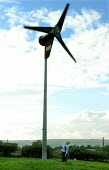 Derbyshire householder checks the wind turbine in his garden which helps power his home. - David Bocking - 2000s,2006,Alternative Energy,capitalism,capitalist,country,countryside,domestic,EBF,Economic,Economy,electric,electrical,electricity,energy,energy supply,eni,ENI environmental issues,environment,envi
